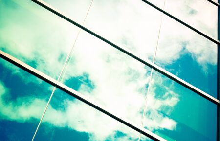 blue sky and white clouds reflected in big windows photo