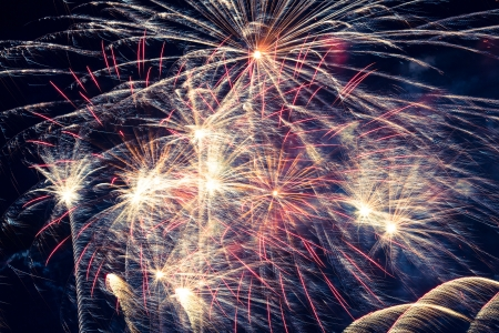Golden fireworks in colorful shades of yellow and orange photo