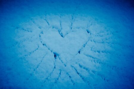 Heart in the snow - valentine's day or christmas background Stock Photo - 17014807