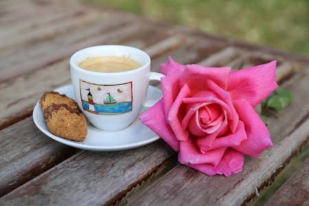 A cup of Italian espresso with a biscuit photo