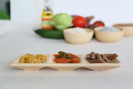 semolina pasta: Italian dried pasta - penne regate, mezze penne tricolore, penne regate integrale- from durum wheat semolina Stock Photo