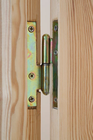 introduced: Door hinge of handmade wooden door Stock Photo
