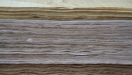 compacted: Distressed pages in coffee are compacted, compressed in single-sheet stationery  Background