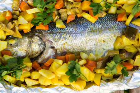 curcumin: Baked sea bass with vegetables in the aluminum foil