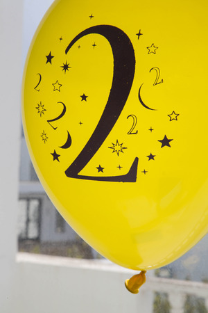Number two printed in black on the yellow balloon photo