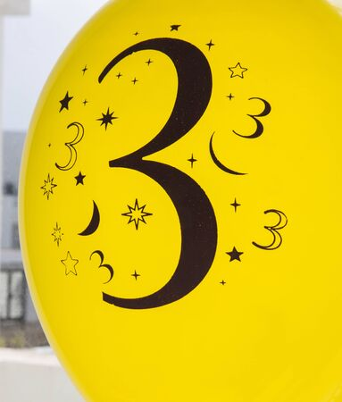 Number three is printed in black on the yellow balloon photo