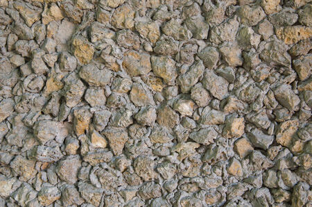 clothed: Wall clothed in stones and concrete.Background Stock Photo