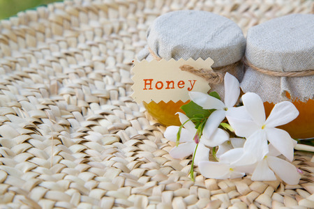 traditional remedy: Two small glasses of jasmin honey on the woven surface