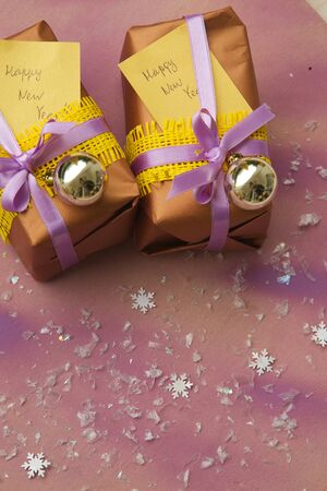 new years day: New Years Day presents - violet-yellow colors Stock Photo