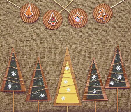Winter holiday background on sackcloth photo