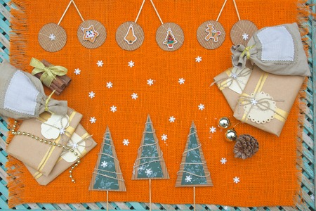 Winter holiday background on sackcloth photo