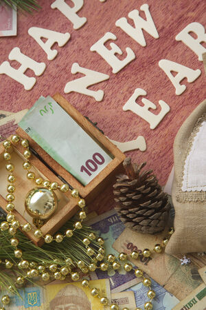 Money present in a small wooden box on a festive background photo