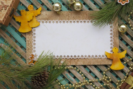 Winter holidays background on a wooden surface. Free space for a text photo