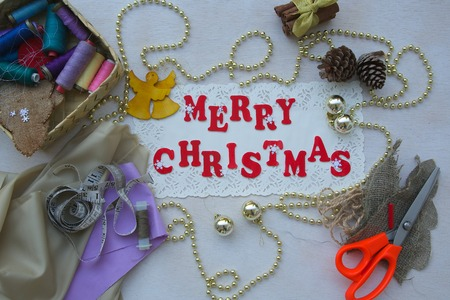 Christmas background for seamstresses with inscription Merry Christmas photo