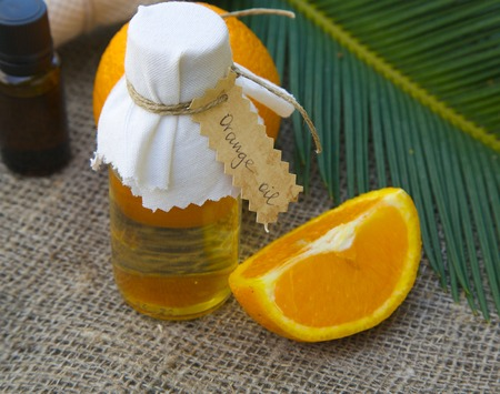 limonene: Bottle of orange oil and one fourth of an orange