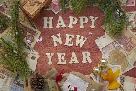 Happy New Year background on a red wooden surface photo