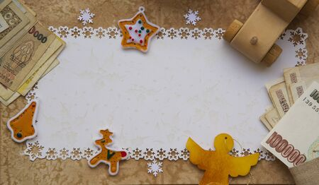 Winter holidays background on a wooden surface. Free space for a text.Close up photo