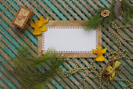 Winter holidays background on a wooden surface photo