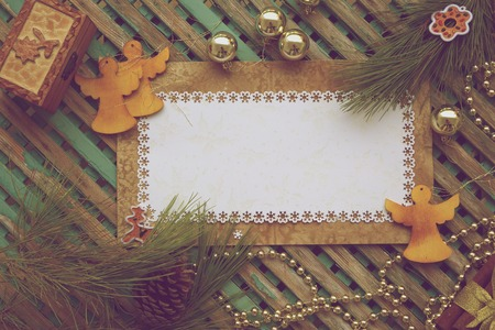 Winter holidays background on a wooden surface. Free space for a text. Vintage photo