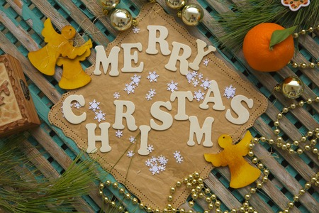 Winter holidays background on a wooden surface with inscription:Merry Christmas photo