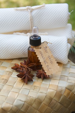insecticidal: A bottle of star anise essential oil on the woven surface