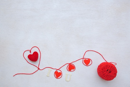 Valentines Day background on a white wooden surface