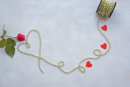 perls: Valentines Day background on a white wooden surface