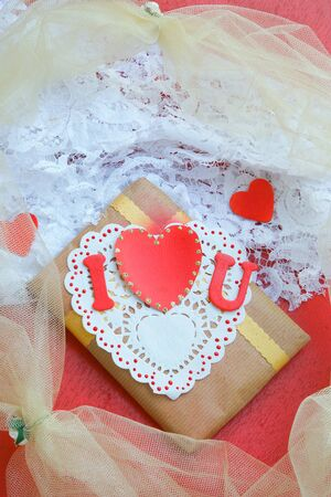 i love u: Valentines Day gift  on a white lace fabric Stock Photo