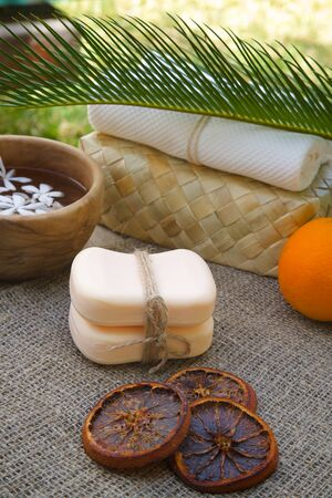 carminative: Two bars of orange soap.Dried and fresh orange in the background Stock Photo