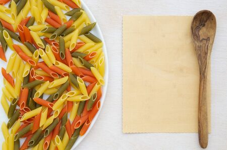 tritium: Raw three-colored Italian pasta. Free space for a text.Background