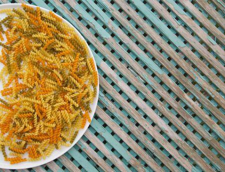 tritium: Raw three-colored Italian pasta. Background