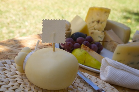 caciocavallo: Italian cheese- caciocavallo on the woven surface with a label. Free space for a text