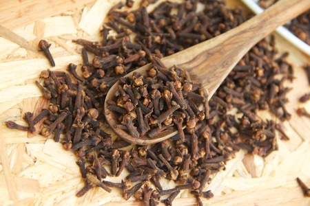 ejaculation: Clove buds in the wooden spoon