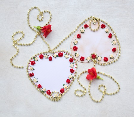 perls: Two handmade carton hearts. Free space for a text