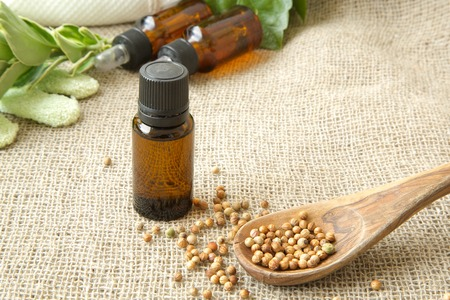 spasmodic: A dropper bottle of white pepper. white pepper grains in the background Stock Photo