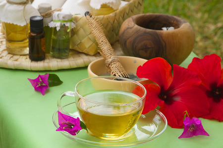 green flowers: Afternoon tea spa day. A cup of tisane on a spa table