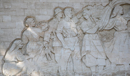 iron curtains: Chisinau, Republic of Moldova. April 8, 2014. Bar-relief of Soviet time. Happy Soviet people reap a harvest together. It is located on the territory of International Exhibition Center MoldExpo