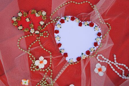 perls: Handmade carton paper heart with artificial mini roses. Free space for a text