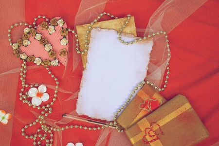 perls: Valentines background on a red surface. Free space for a text. Vintage image style