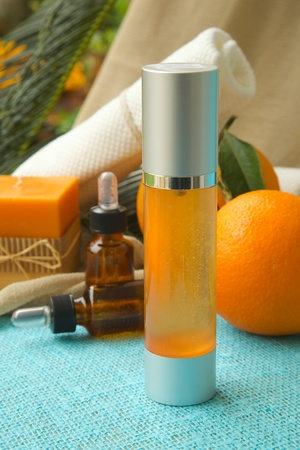 limonene: Hair serum with sweet orange essential oil. Oranges in the background.