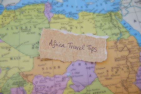 suggestions: Written text on the paper placed on the map of African continent: Africa travel tips Stock Photo