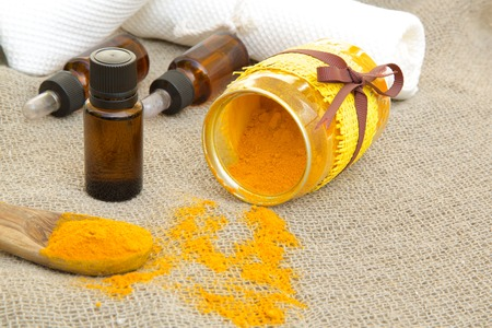 pain killer: A dropper bottle of turmeric essential oil on a sackcloth