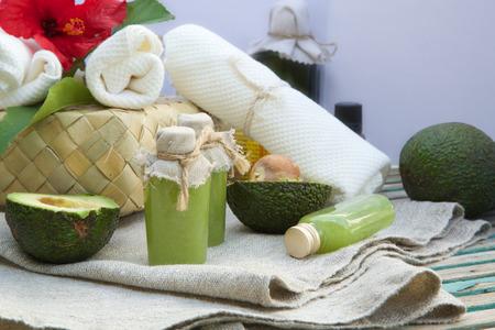 body scrub: Body scrub with avocado oil. Spa products in the background.