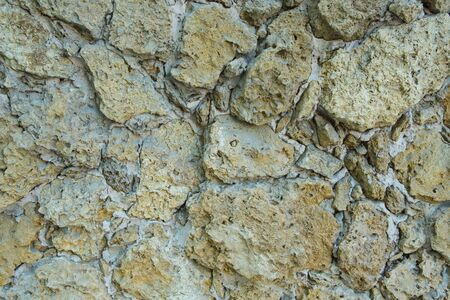 clothed: Clothed wall in stones and concrete-background