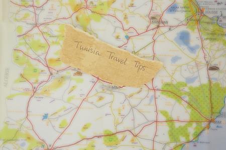 peculiarities: Written text on the text of Tunisia:Tunisia Travel Tips. Close up Stock Photo