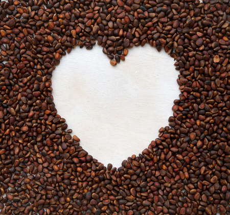 antispasmodic: The white heart on a cedar wood nuts background.