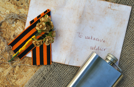 hip flask: Saint George ribbon,hip flask,paper roses,letter to unknown soldier and free space for a text. Background