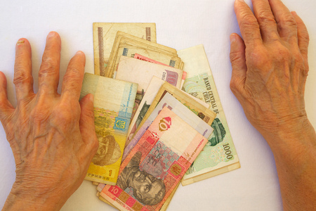 savings problems: Money and hands of senior woman. Top view Stock Photo