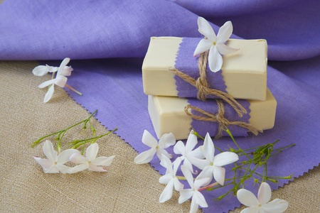 benzoic: Jasmine soap. Jasmine blossoms in the background Stock Photo