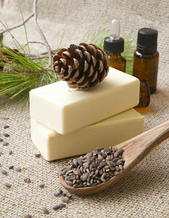 pine kernels: Aleppo pine oil soap. Aleppo pine kernels in the background.